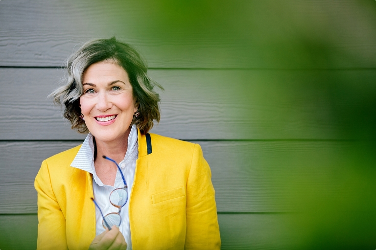 Headshot of business woman in yellow coat